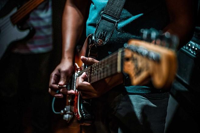 Slide guitarist, turf installer, Switchfoot festival