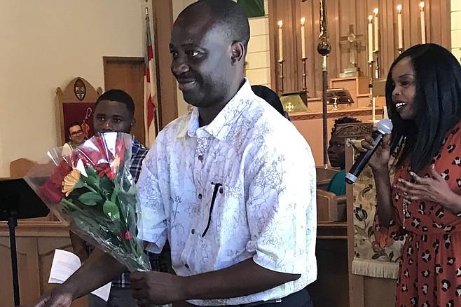 Constantin Bakala accepts welcoming flowers in St Luke's Episcopal Church