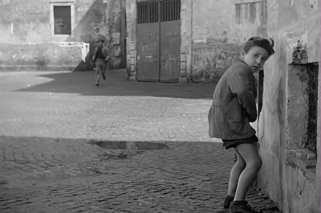The Bicycle Thieves: Enzo Staiola pulls up a wall in the shot in question.