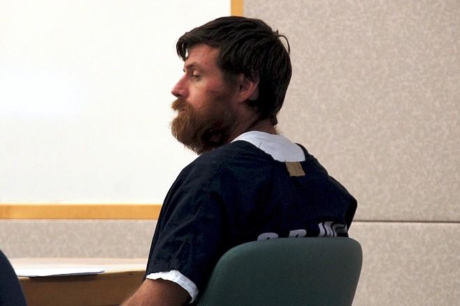 Christian Alexander Katuzin said he doesn't trust law enforcement officers.