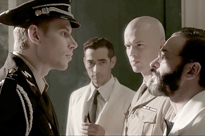 Quezon's Game: The players include the Nazi (Kevin Kraemer), the president (Raymond Bagatsing), the general (David Bianco), and the Jew (Billy Ray Gallion).