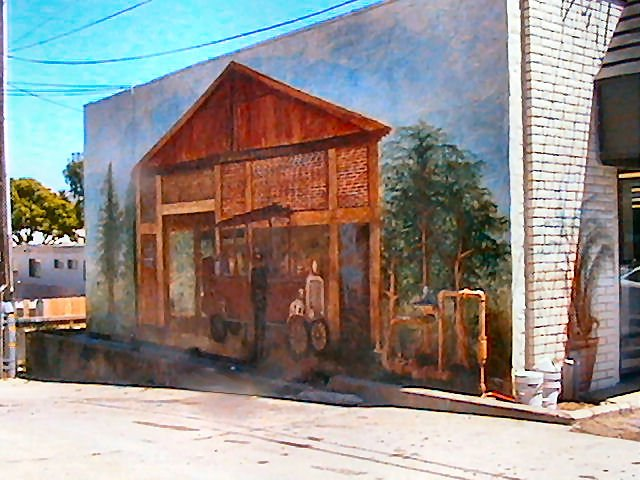 Mural on the wall of the laundromat (in the alley, next to 7-11).