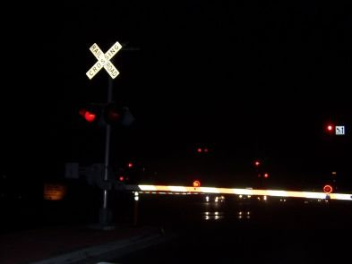 This is a trolley crossing at night on Friars Road.