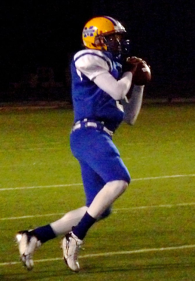 Mira Mesa quarterback Kevin Ozier looks downfield ready to fire