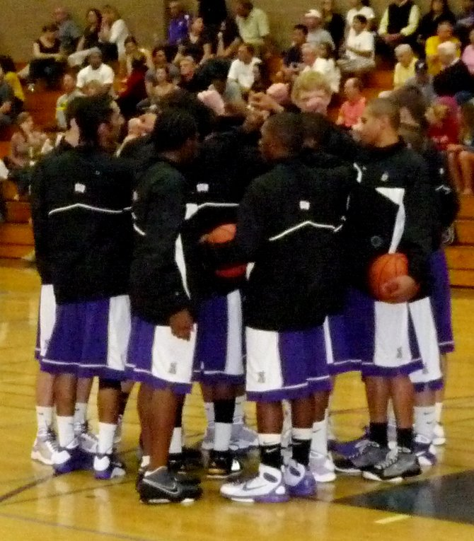 St. Augustine players huddle before the game