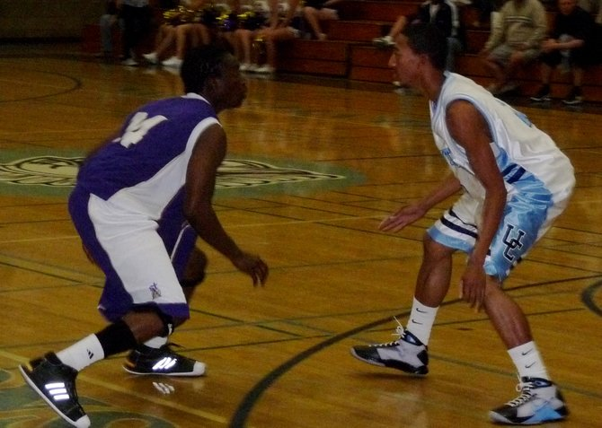 St. Augustine guard Stephon Lamar guarded by University City guard Reynard Rice