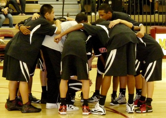 Vista players huddle before the game