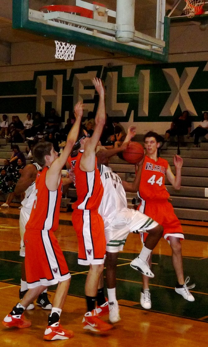Helix guard Joubert Ballard goes up for a layup against a pair of Valhalla defenders