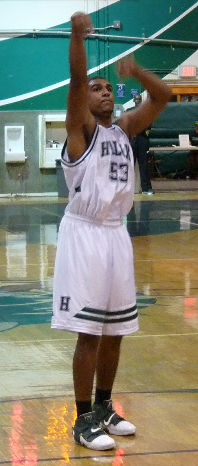 Helix forward Anthony Anderson holds his follow through after a free throw attempt