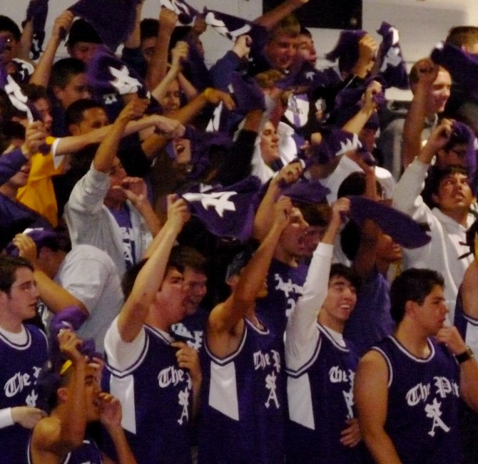 St. Augustine students wave purple towels in the student section