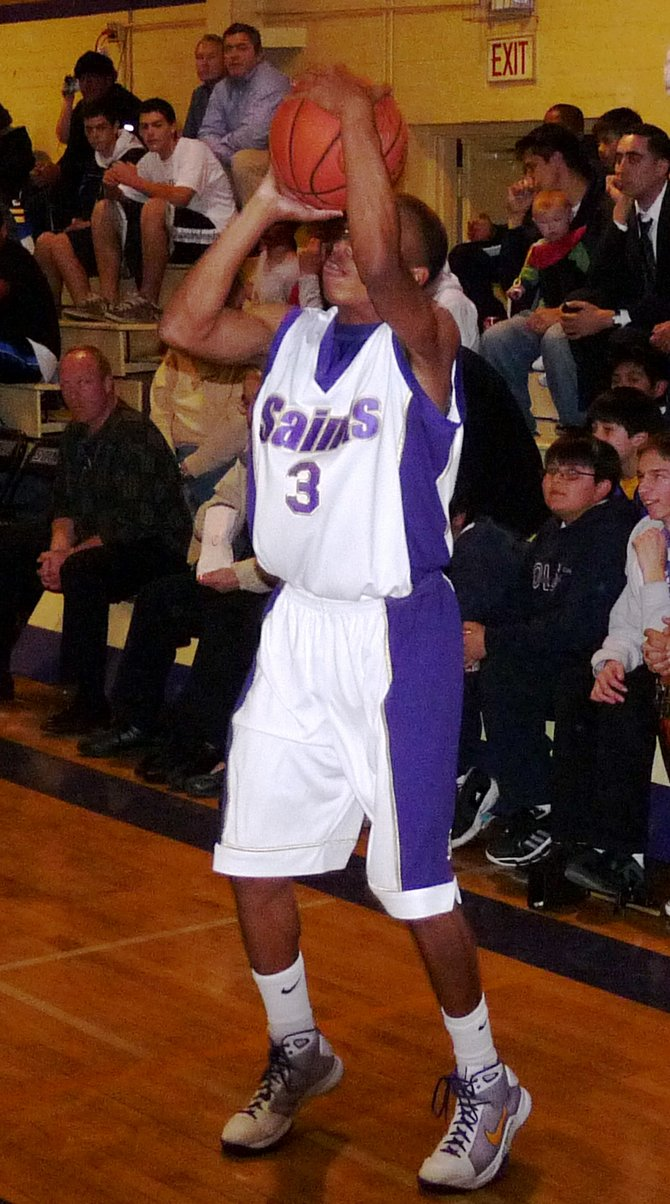St. Augustine senior guard Kaum Brandon shoots a three
