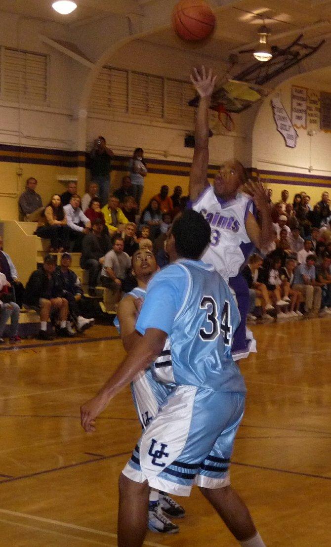 St. Augustine senior guard Kaum Brandon lets go of a runner in the lane