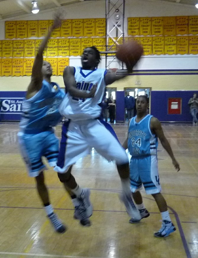 St. Augustine guard Stephon Lamar drives to the hoop against University City guard Reynard Rice