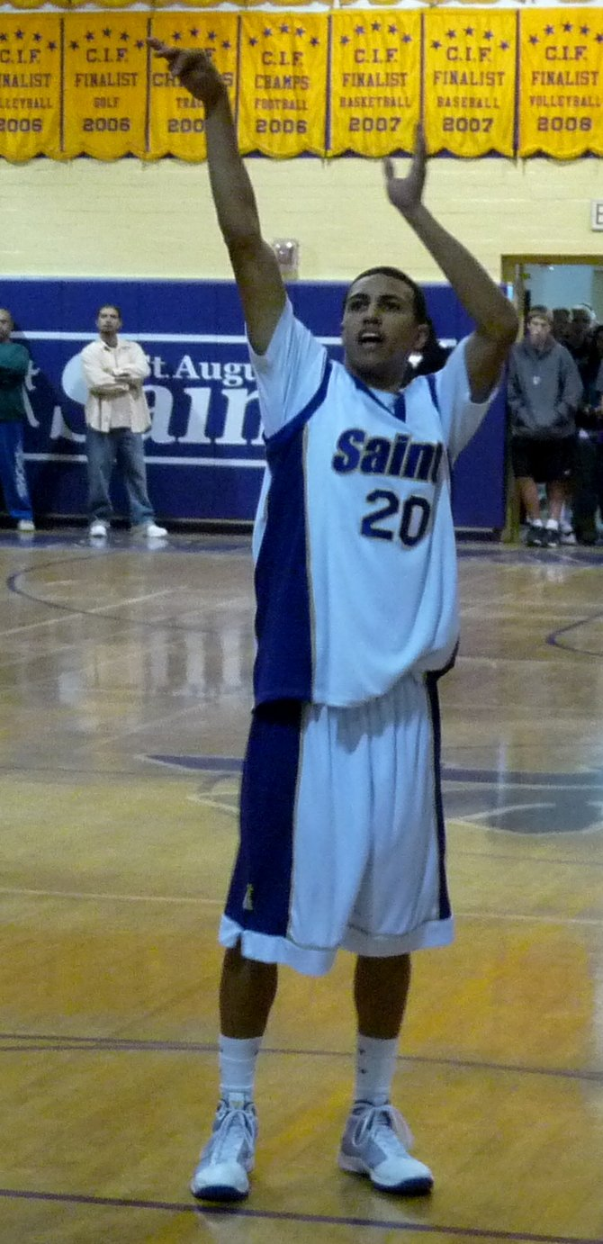 St. Augustine senior guard Kaum Brandon shoots a three