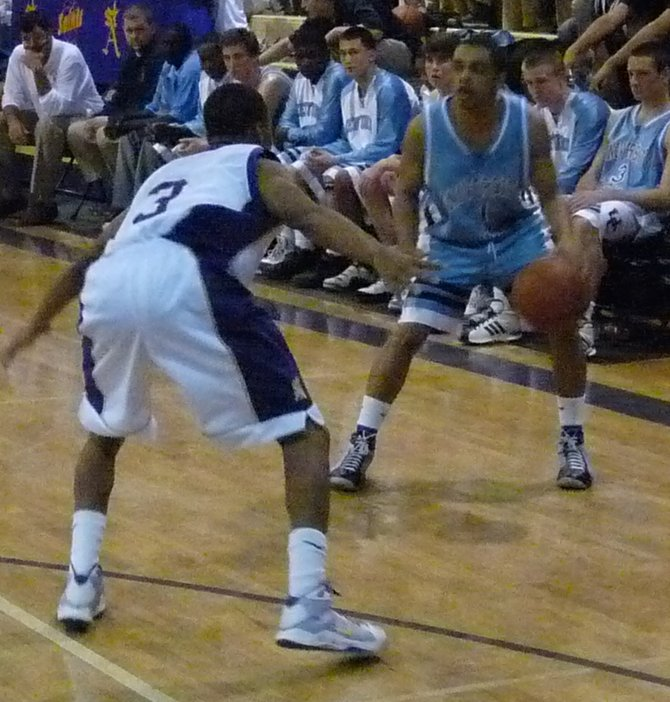 St. Augustine senior guard Kaum Brandon lets go of a runner in the lane