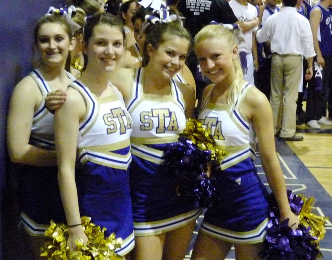 St. Augustine cheerleaders take a minute to smile for the camera