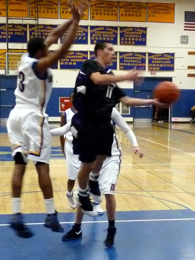 Carlsbad guard Michael Tanael throws an acrobatic pass in the lane