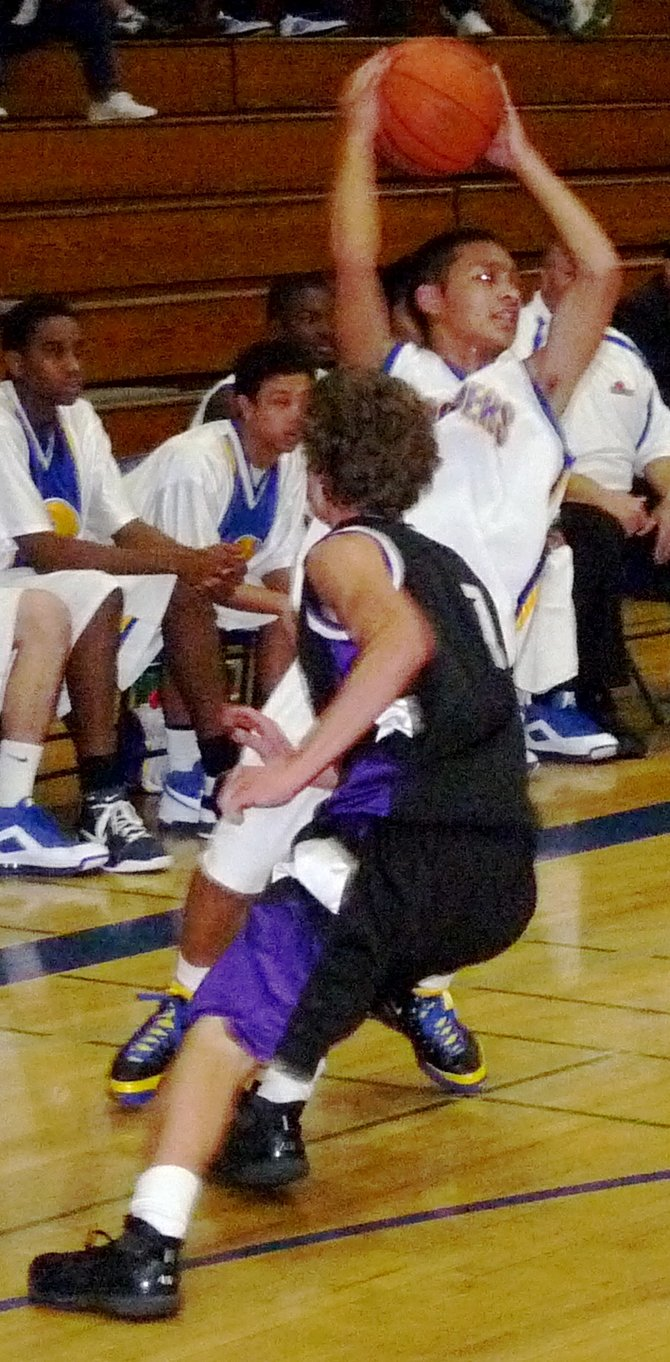 Mira Mesa guard Chris Mendoza leans around Carlsbad guard Sawyer Carlson