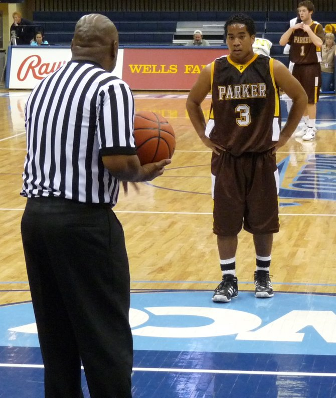Francis Parker guard Deon Randall at the line