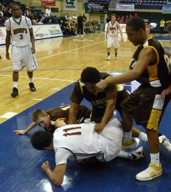 Bishop's guard David Stotlemyre and Francis Parker forward Eric Norman fight for a loose ball
