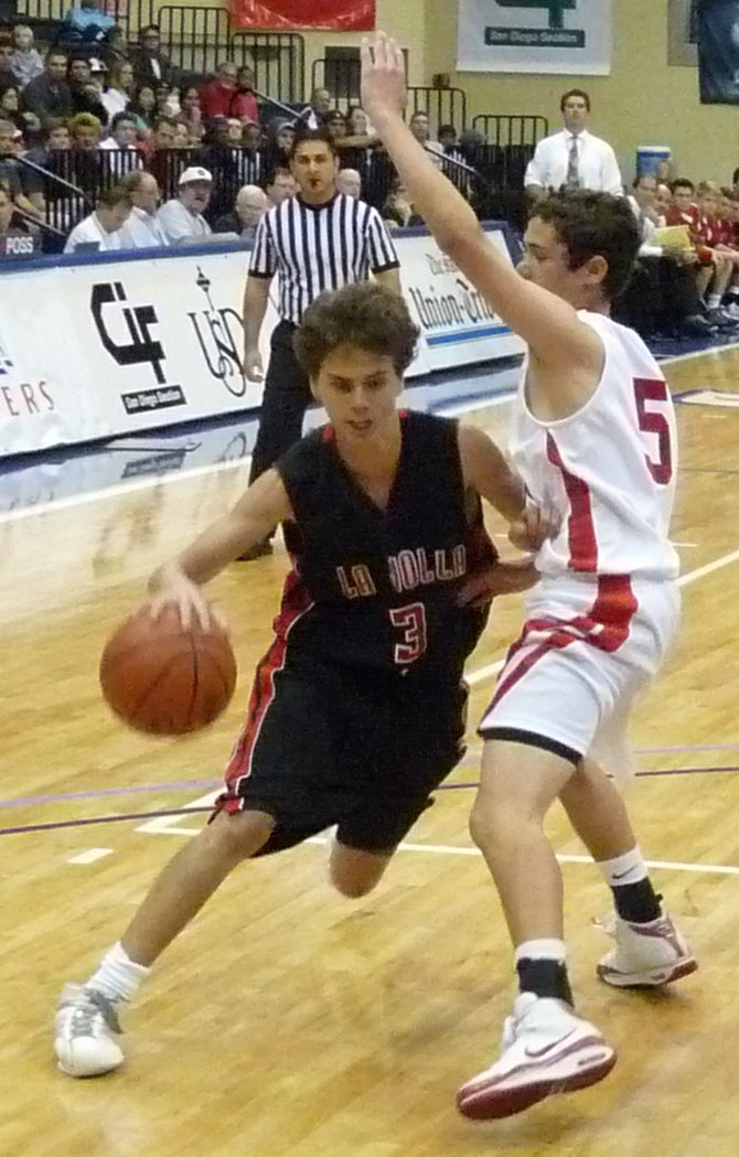 La Jolla guard Max Greenberg drives against Cathedral Catholic guard Matthew Rosenburg