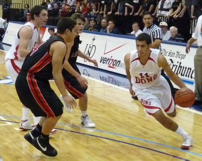 Cathedral Catholic forward Andres Aldrete drives against La Jolla guard Spanky Nawahine