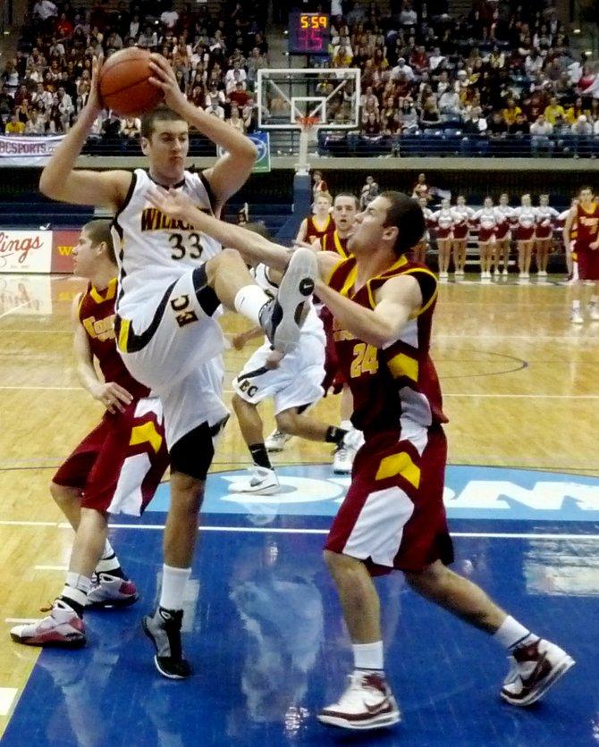 El Camino center Luke Evans pulls down a rebound