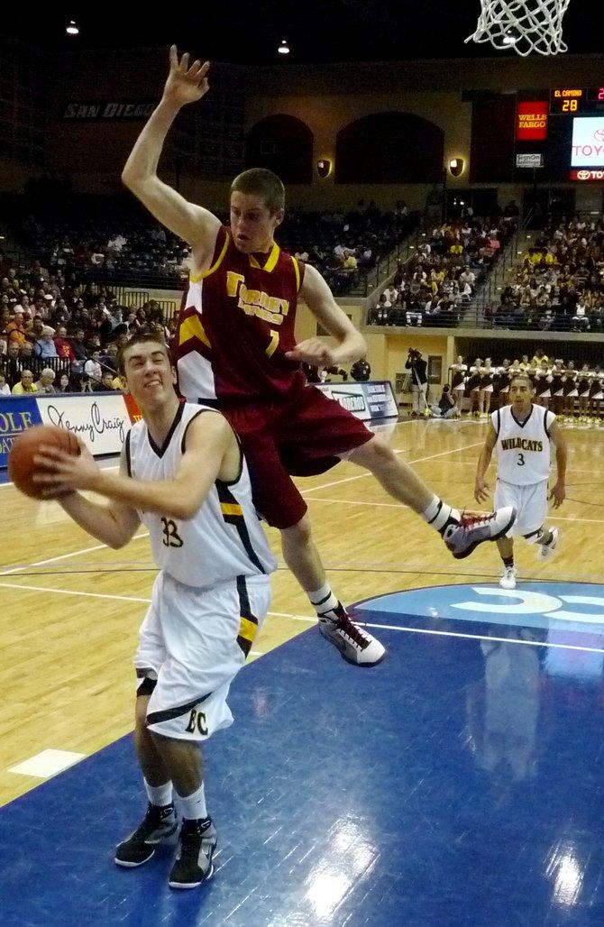El Camino center Luke Evans gets Torrey Pines guard Joe Rahon in the air