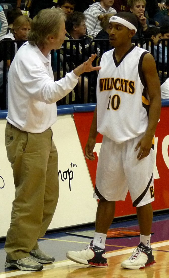 El Camino head coach Ray Johnson talks thing over with Wildcats guard Steven Aldridge