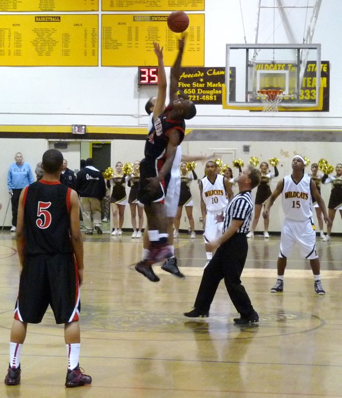 El Camino center Luke Evans and Etiwanda forward Christian Katuala contest the opening tip