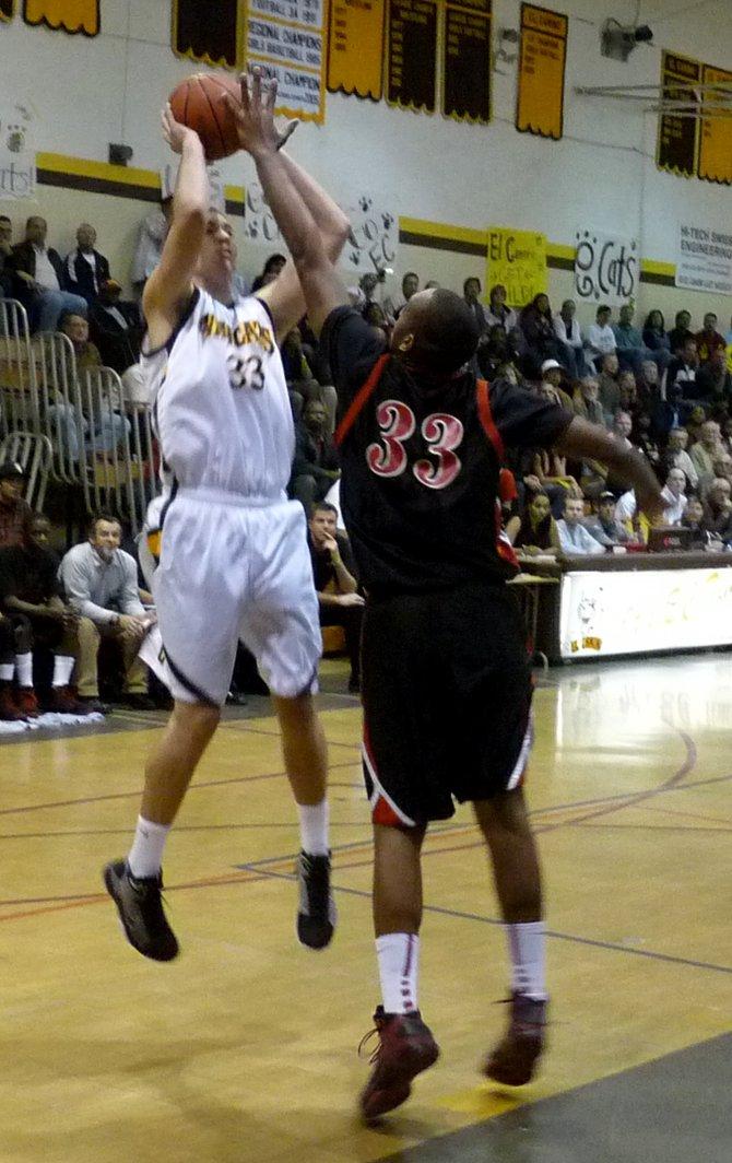 El Camino center Luke Evans shoots a jumper over Etiwanda center Perris Blackwell