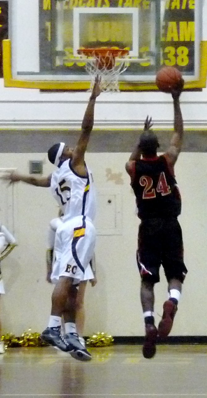 Etiwanda forward Christian Katuala goes up for a shot with El Camino guard Dayton Boddie defending