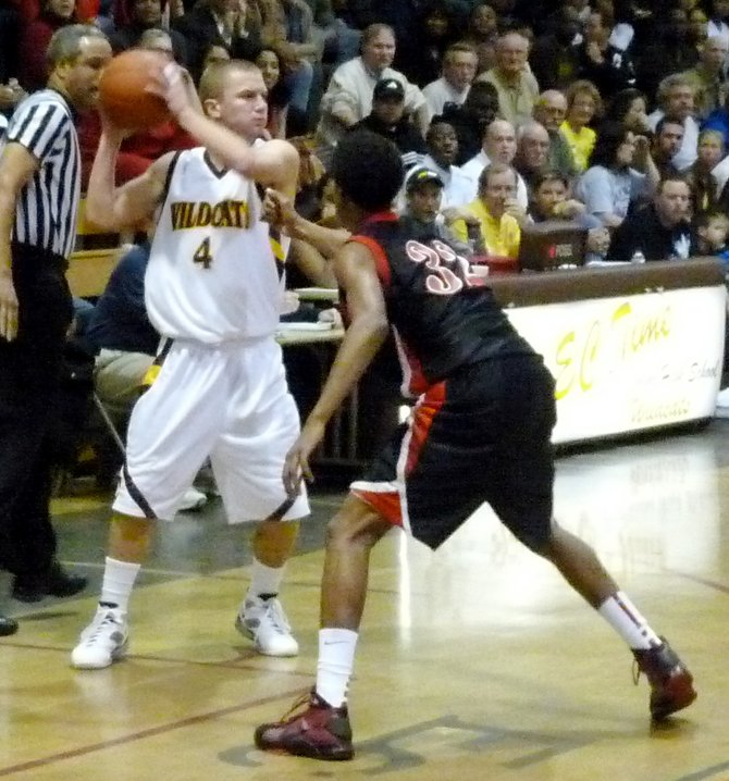 Camino guard Griffin Hunter guarded tightly on the perimeter by Etiwanda guard Deronn Scott
