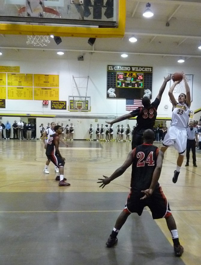 El Camino forward Ryan Ena shoots a jumper from the top of the key