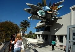 Nancy Rubins's Pleasure Point sculpture at the Museum of Contemporary Art San Diego, 700 Prospect Street, La Jolla. Rubins's 2006 collection of rowboats, canoes, jet skis, and surfboards has been cantilevered over the western, ocean-facing facade of MCASD's La Jolla Museum building. In 1999, Rubins's similar collection of boats — commissioned by the Port District — never made it to the Convention Center after people complained that it looked like a mid-air shipwreck.