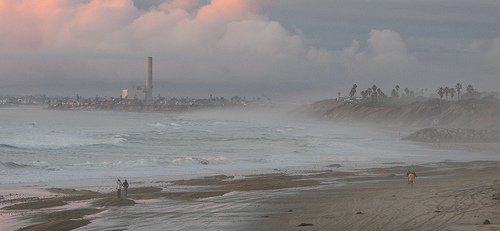A view from the beach looking north towards Carlsbad State beach and the Encino power plant.