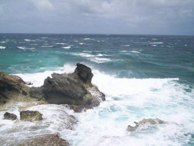 """Isla Mujeres, Mexico: On the """"Cliff of the Dawn"""" on Isla Mujeres. This the eastern most point in all of Mexico.  It is on the eastern tip of the island which is off the coast of Cancun.  This was not an easy picture to take. I had to climb down a slippery wet staircase and watch out for incoming waves to take this shot."""