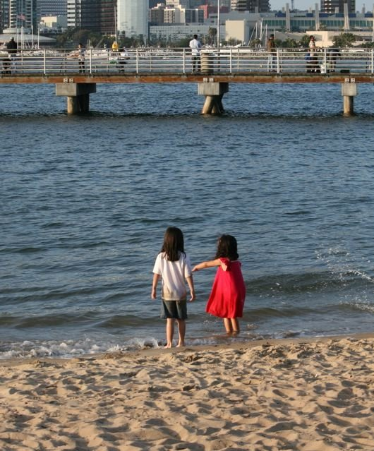 Audrey and her friend Lauren playing in the water at the Coronado ferry landing.