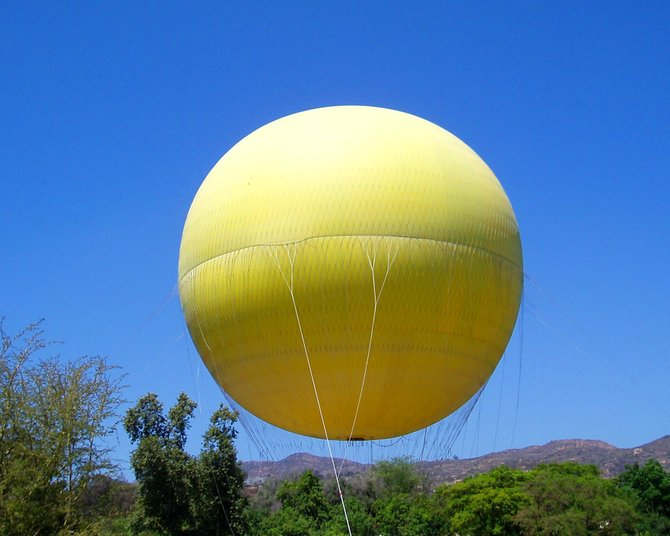 The hot air balloon ride at the San Diego Wild Animal Park hovers gracefully over the Heart of Africa Exhibit like a giant fried egg yolk.