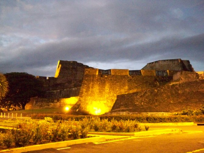 El Castillo San Cristobal lit up against the night sky in San Juan, Puerto Rico.