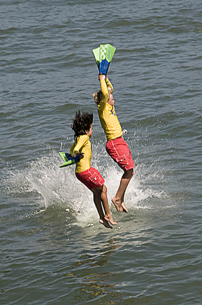 Junior lifeguards jumping from Ocean Beach Pier.