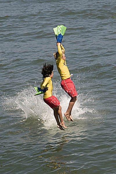 Junior lifeguards jumping from Ocean Beach Pier.