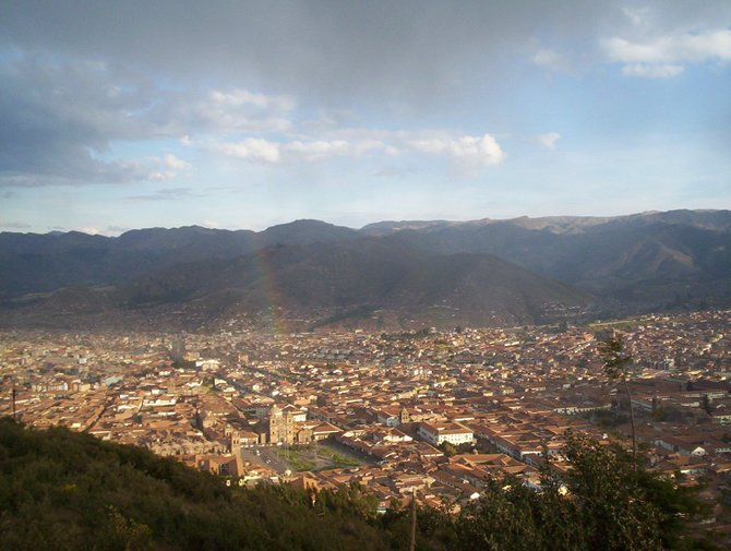 The end of the rainbow is La Plaza de Armas in Cuzco, Peru. This was taken from the ruins of Sacsayhuaman