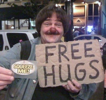 Me (Gadget) sign guy + Free Hugs to everyone !  this is what,I feel that is really important to make people happy +