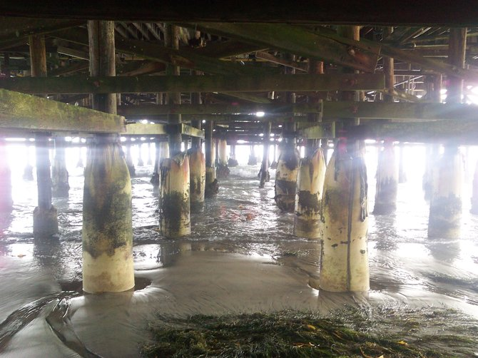 View of the wave coming in underneath the pier