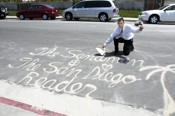 "Alberto Avila (""The Sandman"") creates murals from sand on the street in Coronado. More pictures in my blog."