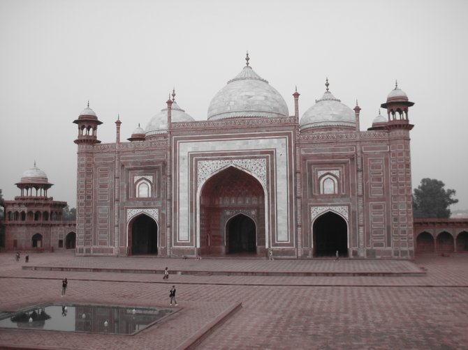 I was standing with my back to the white domed marble mausoleum that you usually see in Taj Mahal pictures. This is the building that stands to the left of the main structure.