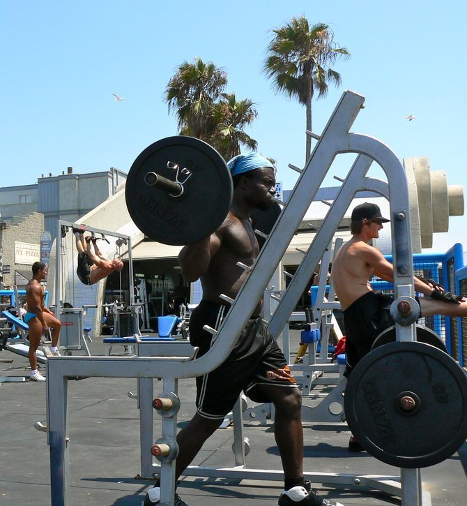Musclemen working out in Muscle Beach, Venice, CA