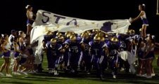 St. Augustine players break through the banner after halftime