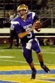 St. Augustine quarterback Evan Crower rolls out